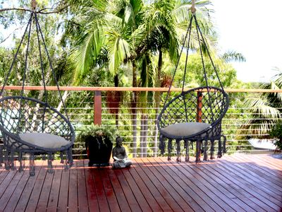 Photo for Treetop ocean views, relax and unwind on the deck looking over Broken head.