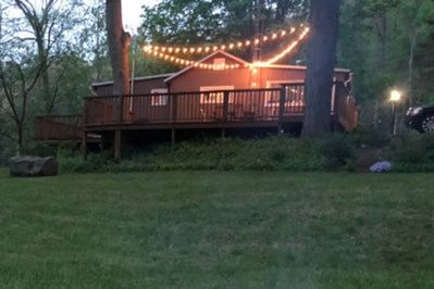 Cabin with evening deck lights