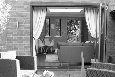 Lounge doors fold back to connect with lodge garden