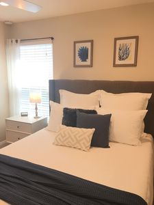 Coastal themed-bedroom with high-end linens make for a restful sleep.