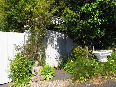 Garden gate leads to your private beach getaway!