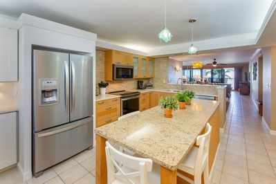 When arriving at the condo, you can view the kitchen to the beach!