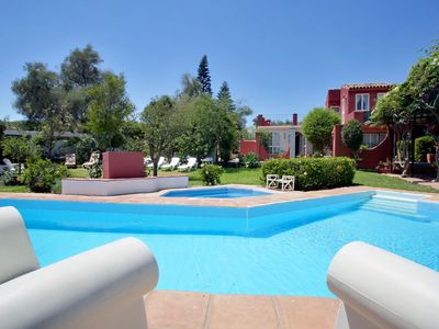 Photo for Perched above the sea, private pool, sea views, jacuzzi & walk to beach & Golf