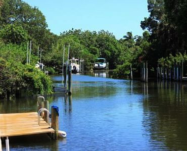 125' OF CANALFRONT! BRING YOUR BOAT, or RENT ONE! 5 MINUTE WALK TO BEACH! POOL!