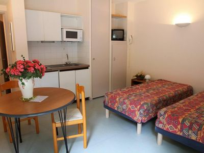 Photo for Surface area : about 25 m². View mountain. Living room with 2 single beds, phone, TV