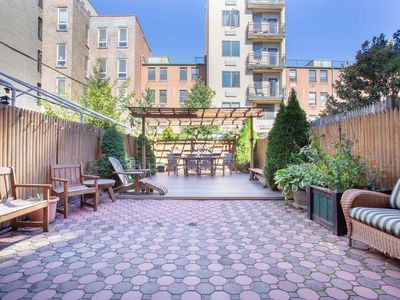 Photo for Spacious Stunning Harlem Townhouse, 3 or 4 Bedrooms 2 Baths, 12 mins to Times Sq