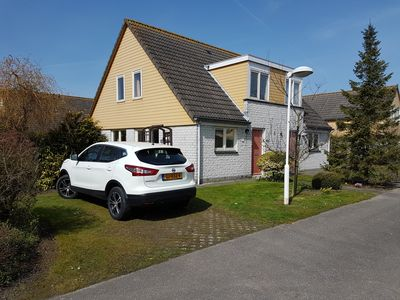 Photo for Holiday home in a quiet holiday park in Zeeland directly on the sea