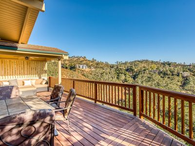 Photo for Gorgeous home with wrap-around deck, private dock, & wonderful lake views!