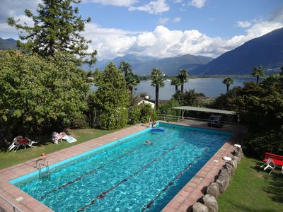 Photo for Modern apartment in quiet location with beautiful lake view and swimming pool