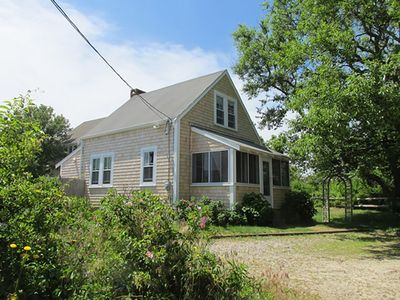 Photo for Renovated beach cottage with private stairs to association beach across the road