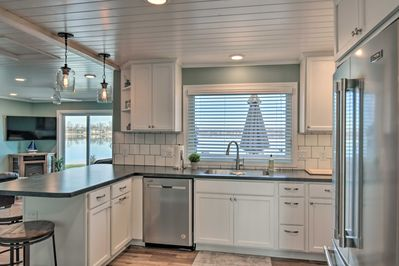 The completely remodeled interior offers stunning lakefront views.