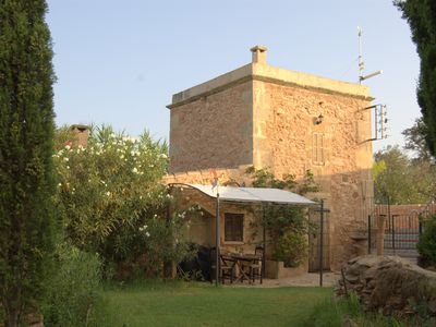 Photo for Old mill in a farmhouse with pool in the middle of an oasis,3 km from the beautiful beach of Es trenc...