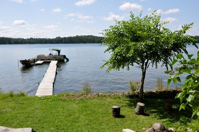 Lush green private shorefront for relaxing. Easily tie your boat up to our dock!