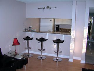 Bar stools in living room to the kitchen raised countertop
