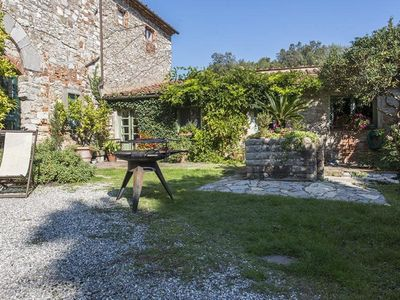 Photo for Spacious Casa Claudia apartment in Lucca with WiFi, private parking, shared terrace & shared garden.