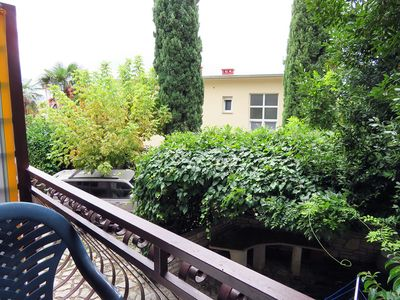 A view and the garden with grill you can use.
