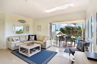 Open plan living area opens up to deck