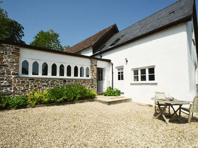 Photo for Luxurious cottage with private lake, fantastic views and walks