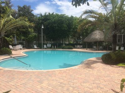relaxing pool with lots of tropical landscaping coral hammock   tropical 3 bedroom home      homeaway stock island  rh   homeaway