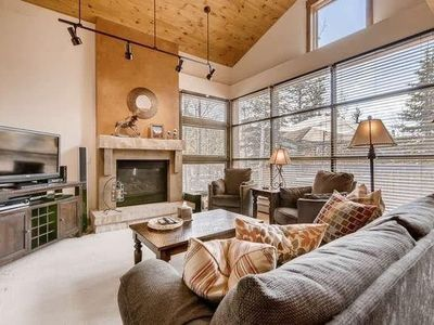 Photo for Updated and Spacious Condo in the Woods - Private Garage - Short Drive to Slopes