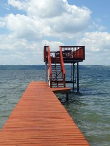 100 Foot Dock with Electric Boat Hoist and 200 sqft Sundeck