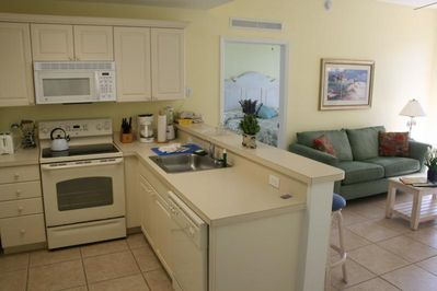 The Cove on Ormond Beach Kitchen with Living Room