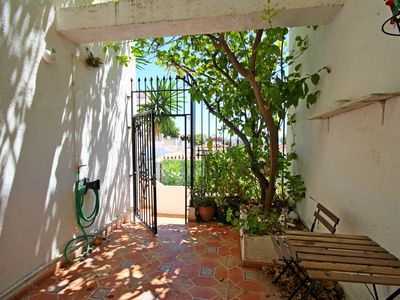 Photo for Townhouse one step away from the beach of Carihuela
