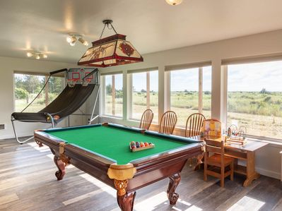 """The downstairs rec room sports arcade basketball, a pool table, ping pong (removable top), Foosball table, XBox One as well as a 55"""" SmartTV with Netflix/Hulu complimentary"""