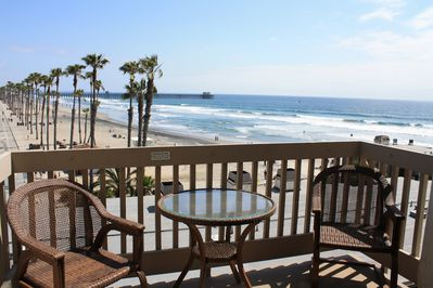 Lower level patio - sand, white water and pier view - facing southwest. by GJT