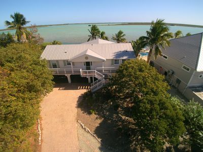 Photo for Waterfront home with open water view, dock, hot tub, private beach, dog friendly