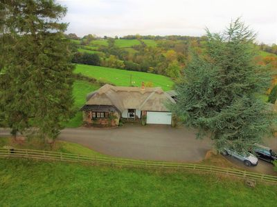 Photo for Luxury, Thatched Picturesque Holiday Cottage, Garden Overlooking Rolling Fields