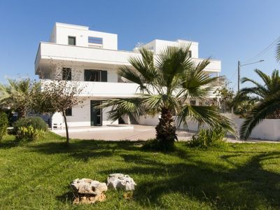 Photo for Vacation home marini beachfront house in Lido Marini - 5 persons, 2 bedrooms
