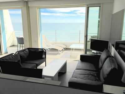 Photo for DIRECTLY ON THE PALAVAS BEACH, Nice T2, facing the sea, renovated.
