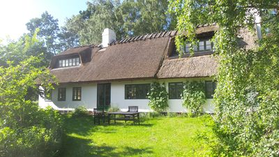 Photo for Farmhouse with charm and comfort in a protected scenic area near the forest and beach.