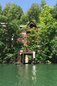 Photo for Great Escape - Beautiful lakefront, 9 bedrooms, 5 baths, 2-story dock w/ slide!