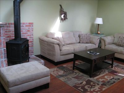 Livingroom - gas fireplace, cozy seating arrangement, drift wood wall sconces.