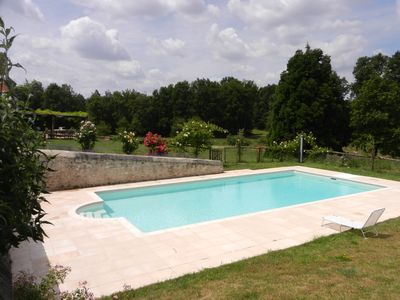 Photo for Typical touraine farm in rural surroundings with lake, woods and swimming-pool.