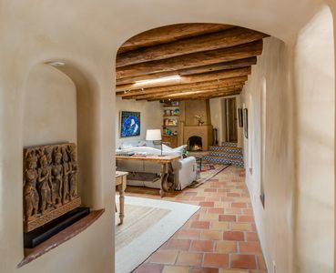 Traditional arched thresholds lend an intimacy to the rooms.