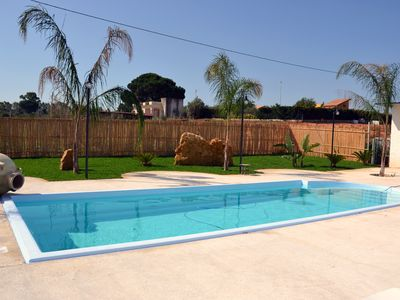 Photo for Villa Katiuscia with private pool, garden, near the beach, wifi free.