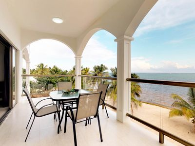 Photo for Oceanfront apartment with amazing views, shared pool access, on the beach
