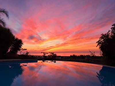 Photo for Tranquility in the olive & citrus groves. Sunsets, sea views & private pool.