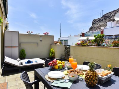 Photo for Penthouse Mogan apartment in Mogan with WiFi, air conditioning, private parking, private terrace & …
