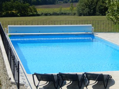 relax by the pool and enjoy the distant sunflowers, barley, wheat or maize