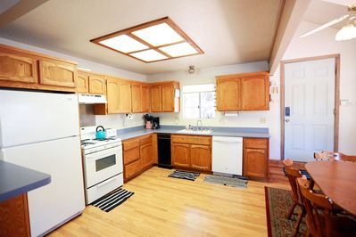 Kitchen with new dishwasher, pots, pans and everything you need to cook.