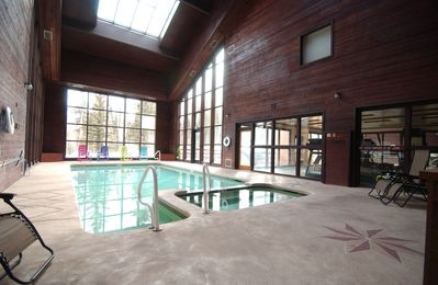Large Solarium pool & Jacuzzi area adjacent to fitness center and dry saunas.