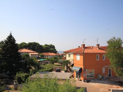 Photo for Two bedroom apartment with terrace Umag (A-7171-a)