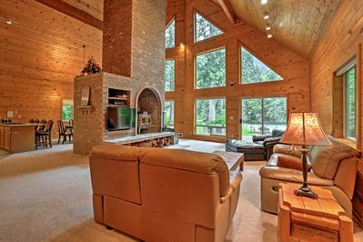 The interior is accented by knotty pine finishes and exposed beams.