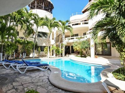 Photo for Blue Palms PH w/ Private Rooftop, Walk to Beach!
