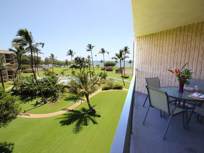 Photo for Pool and ocean views from living room, relax in the a/c or out on the lanai