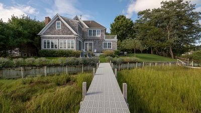 Photo for New Listing: Modern, Beach-Style Home on the Harbor w/ Water Views Throughout, Private Dock